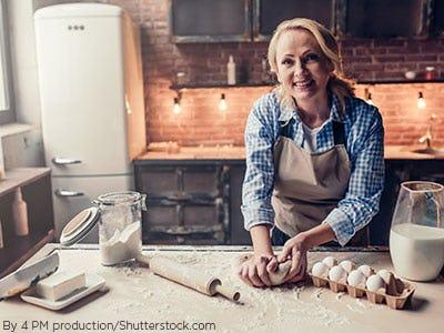 Older woman baking in her kitchen