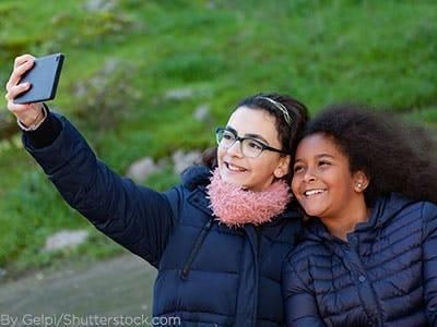 Girls wearing black winter coats.