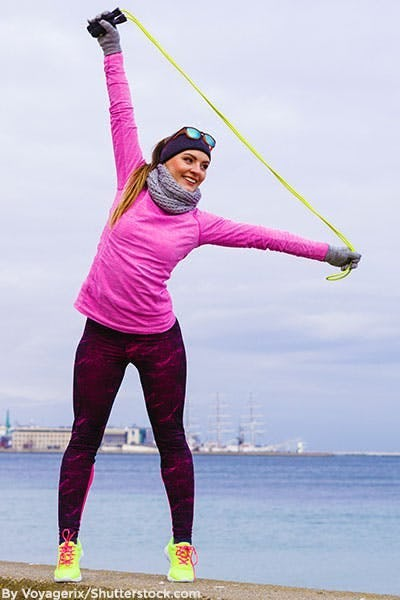 Woman wearing cold weather accessories while working out.