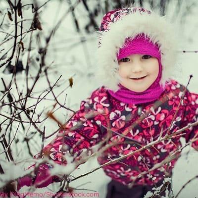Little girl wearing floral snow jacket.