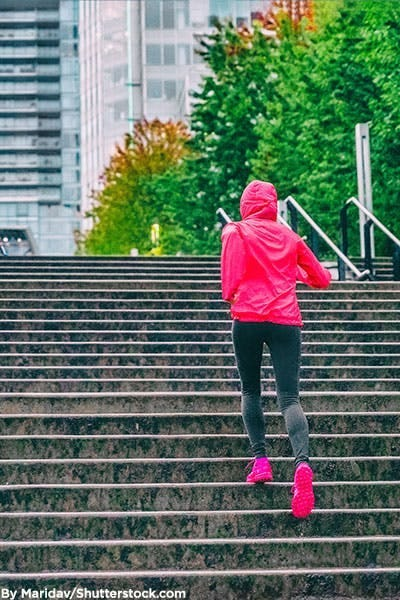 Woman dressed in hot pink activewear.