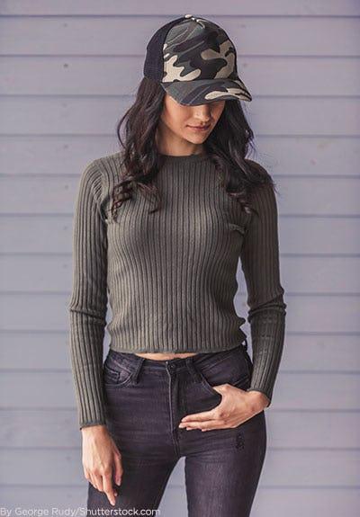 Woman wearing camo baseball hat.