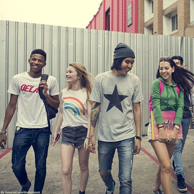 Group of teen students wearing assorted graphic tees.