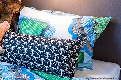 Black cat printed throw pillow for a child's bedroom.