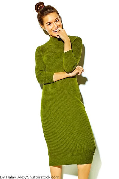 Woman wearing olive green sweater dress.