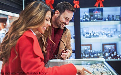 Woman and man shopping for jewelry.