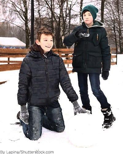 Boys wearing black winter coats.