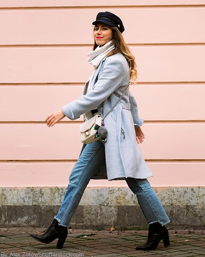 Woman wearing black ankle booties with cropped jeans and a tie waist lavender jacket
