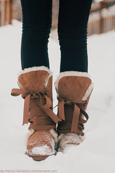 Woman's tan snow boots in the snow