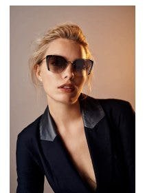 The Prada Cat-Eyed Silhouette with Metal Accents from sunglass hut