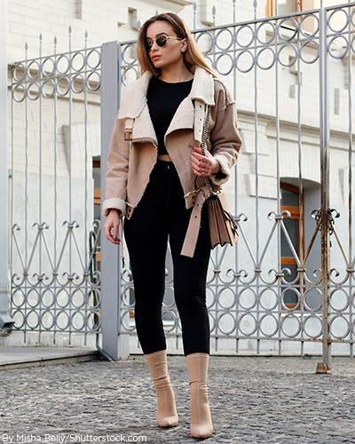 Woman wearing tan sock ankle booties