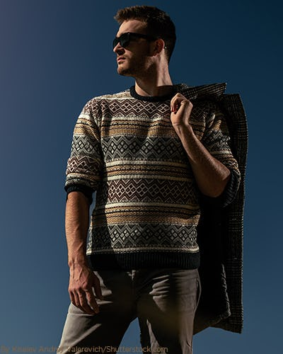 Young man wearing a statement sweater with matching pants