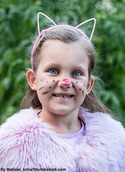 Little girl in cat Halloween costume.