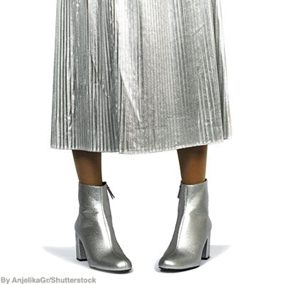 Silver metallic leather booties worn with a silver pleated maxi skirt.