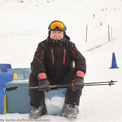 Man wearing ski gear in the snow.