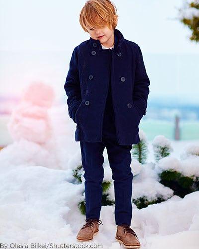Little boy wearing navy blue pea coat.