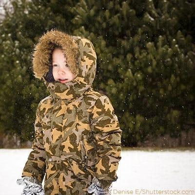 Boy wearing camo snow jacket.