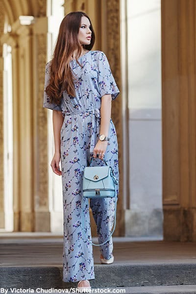 Woman in powder blue floral jumpsuit.