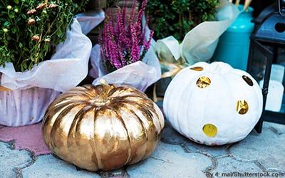 Metallic decorative pumpkins outside