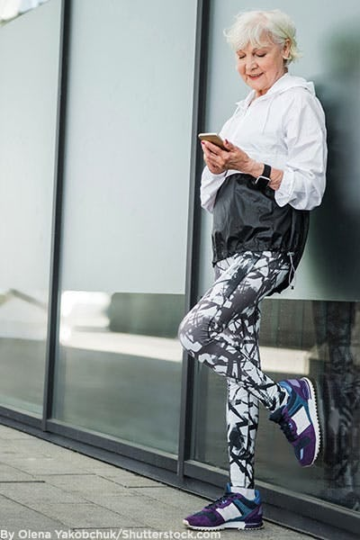 Older woman wearing patterned fitness leggings.