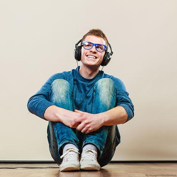 Trendy teen boy wearing distressed jeans.