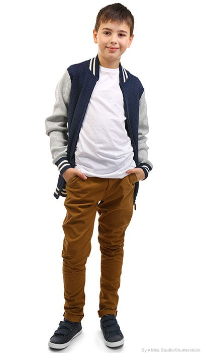 Boy wearing a blue and grey varsity-style bomber jacket, white tee, and camel chinos.