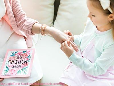 Daughter giving her mother a bracelet