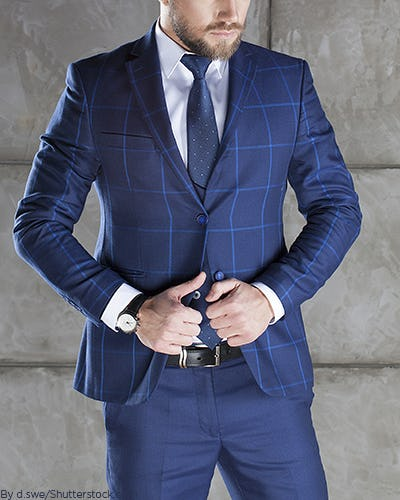 Young man wearing a navy plaid suit