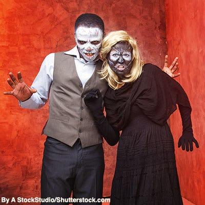 Couple dressed as sugar skulls for Halloween.
