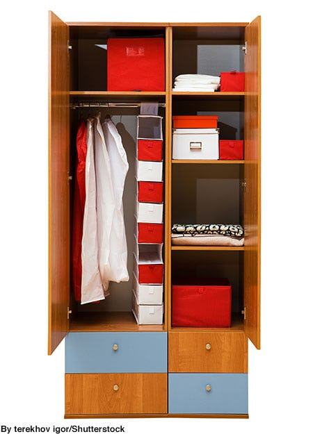 College dorm room wardrobe filled with storage cubes and hanging organizer.