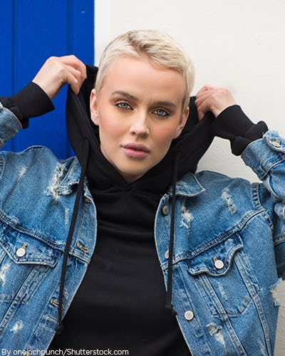 Young woman wearing a black hoodie with a blue jean jacket