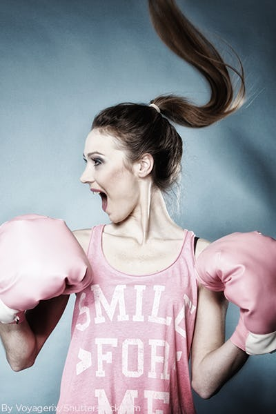 Woman wearing a pink tank top that say Smile for Me with pink boxing gloves