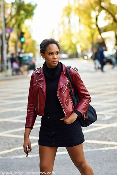 a14d734ee8 Woman wearing black sweater dress with burgundy leather jacket. Chunky Knits