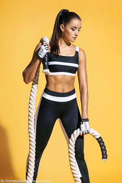 Woman wearing activewear sports bra and leggings that match
