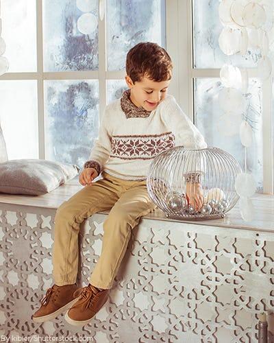 Young boy wearing a festive knit sweater